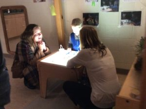 Light table with child and educators