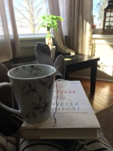 Book and tea in sunny living room